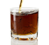 Whiskey being poured into a glass — Stock Photo