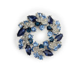 Silver brooch with blue and white gemstones — Stock Photo
