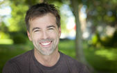 Close-up of a man smiling outside — Stock Photo