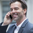 Portrait Of A Successful Businessman On The Phone Smiling At The Camera — Stock Photo