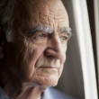 Portrait of Elderly man lost in thought — Stock Photo