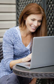 Woman working home on laptop — Stock Photo