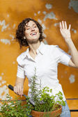 Woman planting in summer — Stock Photo
