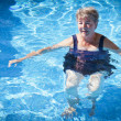 Senior Woman Swimming in the Pool — Stock Photo