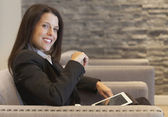 Beautiful Smiling Businesswoman working on tablet at the office — Stock Photo