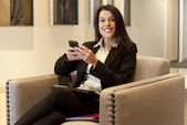 Businesswoman working on cellphone at the hotel — Stock Photo