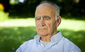 Portrait of Elderly man lost in thought — Stockfoto