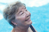 Senior Woman Swimming in a Pool — Stock Photo