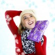 Woman with christmas gift - snowflake — Stock Photo