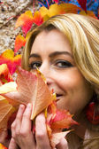 Autumn - beautiful woman wiht leaves — Stock Photo