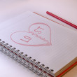 Stock Photo: Draw hart with red crayons