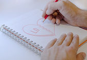 Draw hart with red crayons — Stock Photo