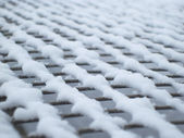 Background grid covered with snow — Stock Photo