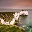 White chalk cliffs ranging into sea in twilight mood — Stock Photo