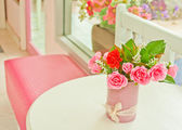 Artificial roses on table — Stockfoto