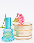 Perfume and powder with flower — Stock Photo