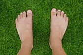 Foot over green grass — Stock Photo