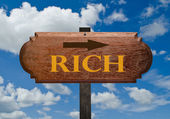 "Teak wood sign with word ""rich"" — Stock Photo"