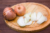 Cut onion on wood — Stock Photo