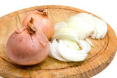 Cut onion on chopping board — Stock Photo