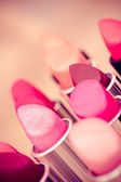 Beauty and cosmetics: colorful lipsticks and lipgloss — Stock Photo