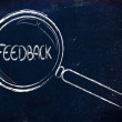 Stock Photo: Finding feedback, magnifying glass focusing on feedback