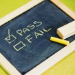 Pass or fail writing on blackboard — Stock Photo