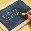 Pass or fail writing on blackboard — Foto Stock