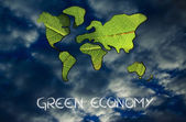 Green economy, world map covered by green leaves — Stock Photo