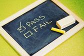 Pass or fail writing on blackboard — Photo