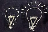 Building a concept, funny lightbulb on blackboard — Stock Photo