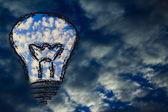 Serene sky inside lightbulb among the storm,creative business vi — Stock Photo