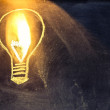 Lightbulb sketch on blackboard with light — Stock Photo