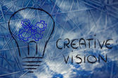 Gearwheels inside lightbulb,creative business vision — Stock Photo