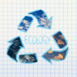 Green economy: recycle simbol on paper notebook — Stock Photo
