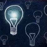 Winning idea, chalk design with lightbulbs — Stock Photo #35510509