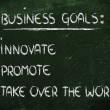 List of business goals: innovate, promote, take over world — Foto de stock #40090299