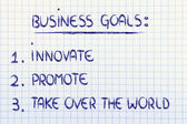 List of business goals: innovate, promote, take over the world — Stock Photo