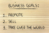 List of business goals: promote, sell, take over the world — Стоковое фото