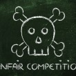 Unfair competition threat, funny skull metaphor — Stock Photo