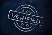 Stamp-like design with the word Verified — Stock Photo