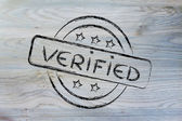 Stamp-like design with the word Verified — Stockfoto