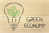 Green economy, leaves growing around an idea — Stock Photo