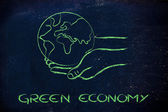 Green economy: hands holding the planet — Stock Photo