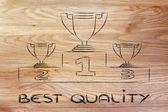 Winning trophy cups on podium — Stock Photo