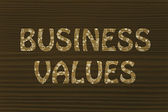 Business values writing with glowing gearwheels pattern — Stock Photo
