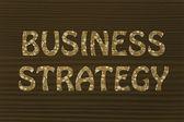 Business strategy writing with glowing gearwheels pattern — Стоковое фото