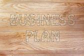 Business plan writing with glowing gearwheels pattern — Stock Photo