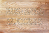 Business success writing with glowing gearwheels pattern — Stock Photo