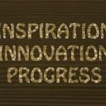 Inspiration, innovation, progress writing with glowing gearwheel — Stock Photo #46481881